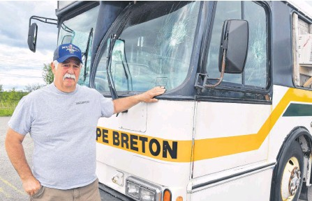 ?? SHARON MONTGOMERY-DUPE • CAPE BRETON POST ?? Gary Pozzebon, president of the Cape Breton Drag Racing Association, shows some of the damage to their bus at their race track off Grand Lake Road in Sydney. Pozzebon said there have been several incidents of vandalism and theft during the five years they've been there and are now having discussions about the land-use agreement they have with local ATV groups.
