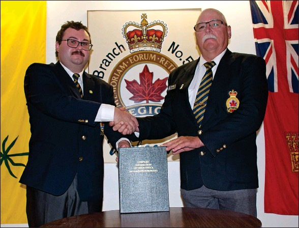 ?? SCOTT ANDERSON/SOUTHWEST BOOSTER ?? Swift Current's John Griffin presented a hard cover copy of Compiled Information on The 8th Recce (14th Canadian Hussars) to Royal Canadian Legion Branch #56 President Andy Moon during a special ceremony this past Saturday.
