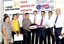 ??  ?? Dilshan Rodrigo, Chief Operating Officer, HNB handing over the key to the first HNB Hire Purchase customer, Ipalawatta Ariyasena