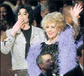 """?? By Kevin Kane, WireImage ?? 2001: Taylor shared glitz and glamour on a night out on the town with close pal Michael Jackson. """"You've got to give it to her,"""" Duke says. """"She never stopped experimenting, trying, playing."""" And he applauds Taylor's decision to wear piles of gems..."""