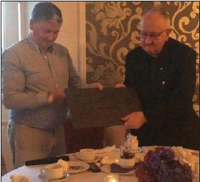??  ?? Patrick Lyne of Cooil, the MC (left) who presented Fr Shanahan with an engraved slab of Valentia slate at the Royal Hotel.