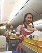 ??  ?? Scoot attendants dressed in Bavarian costumes serve soft drinks, beer and wine.