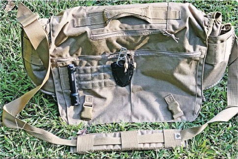 ??  ?? The Summit Side Satchel is available only in olive drab, coyote tan or black. Consider the color and appearance if circumstances dictate a less tactical look. Left: First Tactical's Intelligence Button system features a half-second delay, allowing users to easily find the correct light mode.
