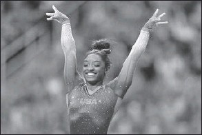 ?? JEFF ROBERSON/AP ?? Simone Biles celebrate her performance on the vault during the women's U.S. Olympic Gymnastics Trials Friday, June 25, 2021, in St. Louis.