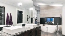 ?? PHOTOS: MCKINLEY MASTERS ?? McKinley Masters' Cambrooke Woodlands home won Best New Home $2.3 million and Over in the CHBA-UDI Calgary Region Association's 2015 SAM Awards. Above, one of the home's sumptuous bathrooms and left, the great room.