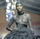 ?? Pic­tures: Kit Bruyns ?? Two of Orape­leng Mo­dutle's cre­ations that were on show at fash­ion week.