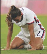 ?? Associated Press ?? AGONY — United States' Tobin Heath reacts after losing 0-3 against Sweden during a women's soccer match at the 2020 Summer Olympics on Wednesday in Tokyo.
