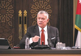 ?? Jordanian Royal Palace ?? King Abdullah II speaks to lawmakers last month in Amman. The king's half brother, Prince Hamzah, says he has been placed under house arrest.