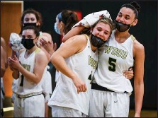 ?? MEDIANEWS GROUP PHOTO ?? Wood's Ryanne Allen (5) congratulates Kaitlyn Orihel (4) after Orihel became Archbishop Wood's leading scorer of all time during their PIAA 4A quarter final game against Gwynedd Mercy.