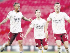 ?? / REUTERS ?? Arsenal's Reiss Nelson, Cedric Soares and Granit Xhaka celebrate in a past match