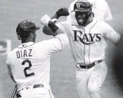 ?? IVY CEBALLO Tampa Bay Times ?? Randy Arozarena celebrates with Yandy Diaz after his solo home run gave the Rays a 4-0 lead Saturday.