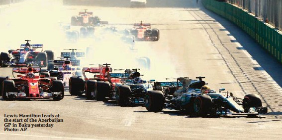 ??  ?? Lewis Hamilton leads at the start of the Azerbaijan GP in Baku yesterday Photo: AP