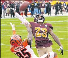 ?? THE ASSOCIATED PRESS ?? Washington cornerback Ronald Darby, shown breaking up a pass intended for Cincinnati wide receiver Tee Higgins in the Bengals' road loss on Sunday, drewpraise Monday fromcoach Ron Rivera.