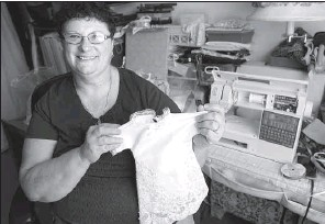 ?? Pittsburgh Post-Gazette/PAM PANCHAK ?? Rose Ann Milbert of Pittsburgh leads a local initiative to create ''angel gowns,'' small dresses repurposed from donated wedding gowns for stillborn babiess or those who die in the hospital.