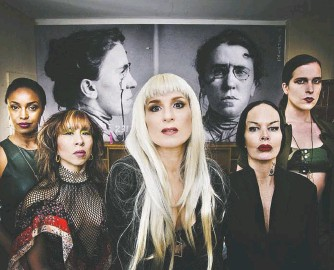 "?? CARTILAGE FILMS ?? Susanne Sachsse, center, and other lesbian separatist­s offer shelter to a male traveler in the campy ""The Misandrist­s,"" from queer filmmaker Bruce La Bruce."