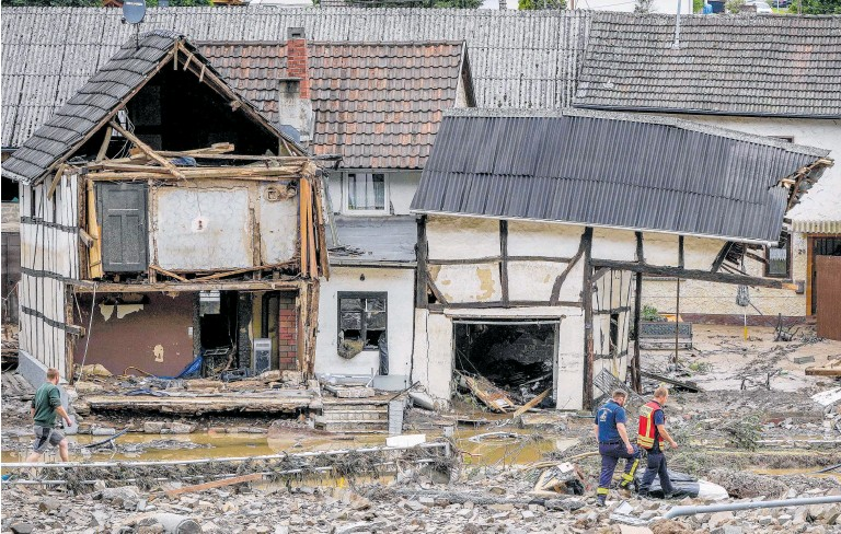 ?? Photo / AP ?? Among the worst-hit German villages was Schuld, where several homes collapsed and dozens of people remained unaccounted for.