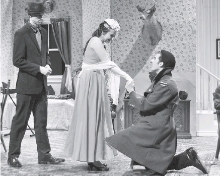?? KAYLIN ENRIGHT PHOTO ?? The cast, including Cody McLaughlin, left, and Tara Patterson as a loving couple facing obstacles, and Alex Elton, right, as Boris Kolekhov, was solid in St. Joseph Catholic High School's production of You Can't Take it With You.