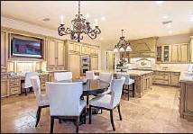 ??  ?? FEATURES include a gourmet center island kitchen.