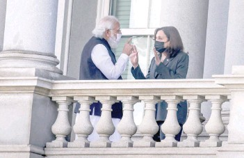 ?? — Reuters ?? US Vice-president Kamala Harris talks with Indian Prime Minister Narendra Modi on the balcony of the Eisenhower Executive Office Building in Washington.