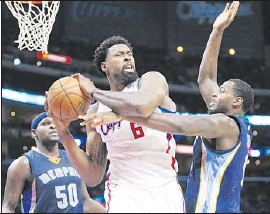 ?? DannyMoloshok Associated Press ?? DeANDRE JORDAN, seen in action against the Memphis Grizzlies in April, has re- signed with the Clippers for four years and $ 87.6million.
