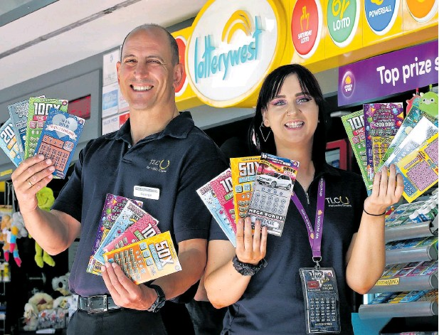 ?? Picture: David Baylis www.communitypix.com.au d497503 ?? The Lucky Charm Express owner George Georgiou and senior staff member Jodie Colton are hoping for more scratchie success this year.