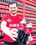 ??  ?? Mr Delialis shows Coca-Cola bottles bearing girls' nicknames and catchphras­es.