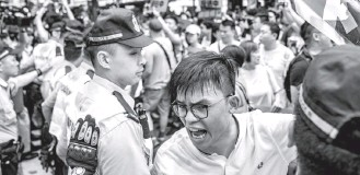 ?? ANTHONY KWAN/GETTY IMAGES ?? Protesters rally on Sunday in Hong Kong.