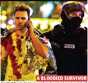??  ?? A BLOODIED SURVIVOR Out of hell: Drenched in blood, a survivor phones loved ones to say he's safe