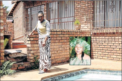 ?? PHOTO: MDUDUZI NDZINGI ?? Agnes Monamodi stands at the scene where the body of her elder sister Refilwe Rebecca Monamodi, inset, was found after she was allegedly strangled by her daughter and dumped into a swimming pool behind her house.