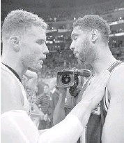 ?? MARK J. TERRILL/AP ?? L.A. forward Blake Griffin, left, talks with San Antonio's Tim Duncan after Game 7 of their series Saturday. The Clippers' victory means there will be no repeat NBA champion this season.