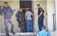 ??  ?? POLICE SEAL off the murder scene in Haifa yesterday. (Omri Stein/Flash90)