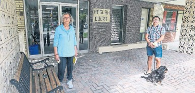 ?? ANDREW FRANCIS WALLACE TORONTO STAR ?? Ann Eyerman and Thania Veja, with dog Cassius, stand outside 40 Raglan Ave., which is set to be demolished to make way for a 28-storey rental tower. The tenants fear they won't be able to find comparable units in today's rental market.