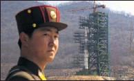 ?? By David Guttenfelder, AP ?? Kicking up nuclear tension: A North Korean soldier guards a Unha-3 rocket on April 8. It may be the one launched early today.
