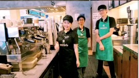 ??  ?? (From left) Lo with deaf baristas Liza Mohammad and Foon Kar Mun behind the counter at Starbucks Signing Store in Bangsar Village 2.