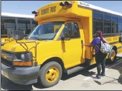 ??  ?? PHOTO COURTESY CANDACE CRAVEN/PALMDALE SCHOOL DISTRICT Driver Latina Pinkney gets ready to run her route after a safety check. Thieves stole catalytic converters from nine Palmdale School District special education buses over the weekend.