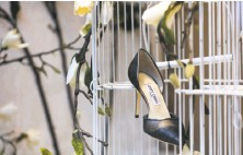 ?? Gabrielle Lurie / Special to The Chronicle ?? A Jimmy Choo shoe is displayed on a birdcage in a striking display in the Wilkes Bashford store on Sutter Street.