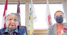 ?? FEDERATION OF SOVEREIGN INDIGENOUS NATIONS • HANDOUT VIA REUTERS ?? Cowessess First Nation Elder Florence Sparvier, left, and Chief Cadmus Delorme discuss the discovery of the unmarked graves of hundreds of people, in a still image from a videoconference in Grayson, Sask. on Thursday.