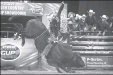 ??  ?? Zane Lambert from Ponoka holds on tight for one of his PBR winning rides in Lethbridge.