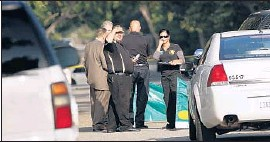 ?? Al Seib Los Angeles Times ?? LOS ANGELES COUNTY coroner officials and sheriff's deputies investigate the fatal shooting of Joseph McMahon in east Pasadena on Friday.