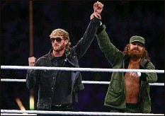 ??  ?? YouTube celebrity Logan Paul, left, is introduced by Sami Zayn. Let's just say Paul was not a fan favorite.