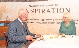 ??  ?? We hae meat Prince Charles and Camilla enjoy some haggis and a dram