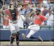 ?? DAVID GOLDMAN/ASSOCIATED PRESS ?? The Atlanta Braves' Jason Heyward scores past Arizona Diamondbacks catcher Miguel Montero off a single by Justin Upton in the first inning Friday in Atlanta. The Braves won 3- 0.