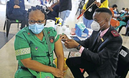 ?? Picture: Thapelo Morebudi ?? An Emergency Medical Service member getting vaccinated at Charlotte Maxeke Hospital, a Covid-19 vaccination site.