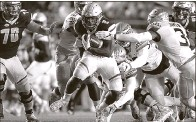 ?? Associated Press ?? AJ Dillon rushes for a game-high 149 yards on 33 carries and a touchdown to lead Boston College's victory over Florida State.