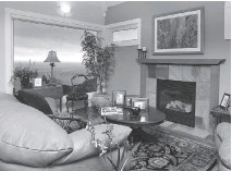?? JOHN McKAY/POSTMEDIA NEWS ?? To reduce stress, cultivate coziness in hour home, allowing the rooms to be darker and more intimate.