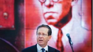 ?? (Jonatan Sindel/Flash90) ?? PRESIDENT ISAAC Herzog speaks at a memorial ceremony for Zionist leader Ze'ev Jabotinsky at Mount Herzl in Jerusalem last week.