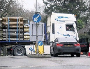 ??  ?? A lorry attempts to turn into Mersham on Monday as drivers continue to struggle to find the Sevington lorry park