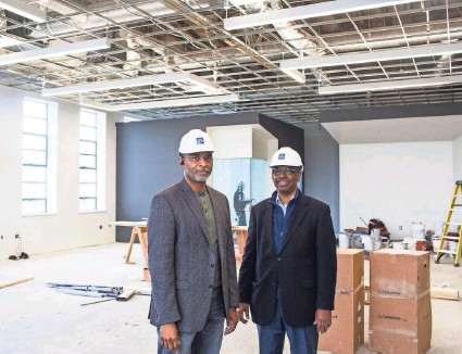 ??  ?? Owners and architects Juan Self, left, and Jimmie Tucker stand inside what will be their new offices at the Universal Life Insurance building at 480 Dr. Martin Luther King Blvd. BRAD VEST / THE COMMERCIAL APPEAL