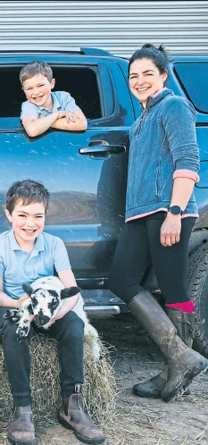 ??  ?? Kieran and Linda McCullough with children, left to right, Rory, six, Lewis, nine, and Blair, eight, with their Ford Ranger at the family farm in Achnamara, Argyll Picture: Andrew Cawley