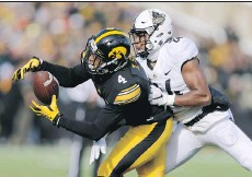 ??  ?? Iowa receiver Tevaun Smith catches a pass against Purdue last season. Smith, a Toronto native, might be drafted by an NFL team later this month.